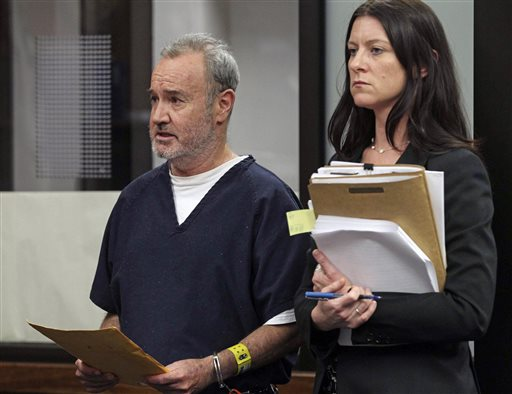 "Peter Robbins, the original voice of Charlie Brown in ""Peanuts"" television specials, appears in court with attorney Kristin Scogin on Wednesday, May 8, 2013, in San Diego. Robbins was sentenced Wednesday to a year in jail for threatening his former girlfriend and stalking her plastic surgeon, then immediately released to a residential drug treatment center. (AP Photo/U-T San Diego, John Gibbins)"