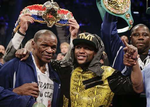 Floyd Mayweather Jr., right, poses for photos with his father, Floyd Mayeather Sr.  (AP Photo/Rick Bowmer)