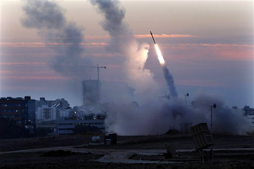 In this Thursday, Nov. 15, 2012 file photo, the Iron Dome defense system fires to intercept an incoming missiles from Gaza in the port town of Ashdod, Israel. Israel's military has deployed Iron Dome defense system to the north of the country following Israeli airstrikes in neighboring Syria targeting weapons believed to be destined for Lebanon's Hezbollah militants. Iron Dome protects against short-range rockets and Hezbollah has thousands of such projectiles. (AP Photo /Tsafrir Abayov, File)