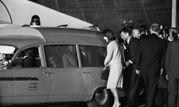 US first lady Jacqueline Kennedy and Robert Kennedy get into the Navy ambulance which carries the body of slain President John Fitzgerald Kennedy, on November 22, 1963 at Andrews Air Force Base, just outside Washington, DC. (AFP/Getty Images)