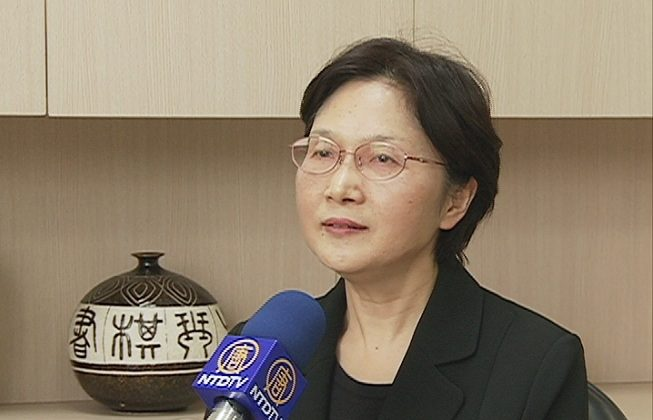 Ruey-lan Chang, the head of New Tang Dynasty, Asia-Pacific, talks to a reporter about the successful renewal of the company's contract with Chunghwa Telecom, the largest telecommunications company in Taiwan. (Screenshot via The Epoch Times)