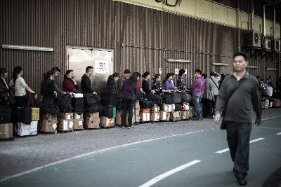 Hong Kong's North Sheng Shui Railway Station is flooded by passengers attempting to carry milk powder to mainland China under the milk purchase restriction. Chinese parents try hard to buy milk powder overseas, causing various areas and countries to issue restrictions on milk purchase. (Getty Images)