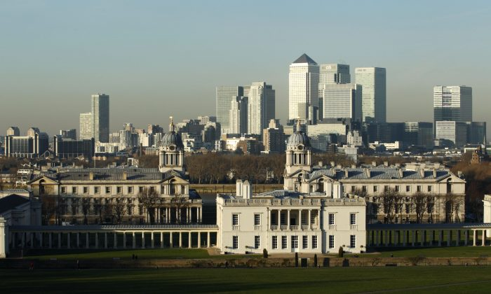London's financial district of Canary Warf stands in the background of Greenwich Park. The government is struggling to live up to claims that the country will shift away from its reliance on financial services with a growth in manufacturing (JUSTIN TALLIS/AFP/Getty Images)