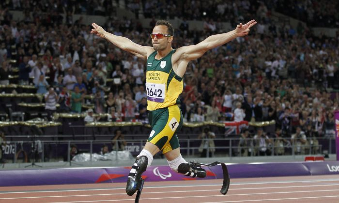 South Africa's Oscar Pistorius crosses the line to win gold in the men's 400m - T44 final during the athletics competition at the London 2012 Paralympic Games at the Olympic Stadium in east London on September 8, 2012. (Ian Kington/AFP/Getty Images)