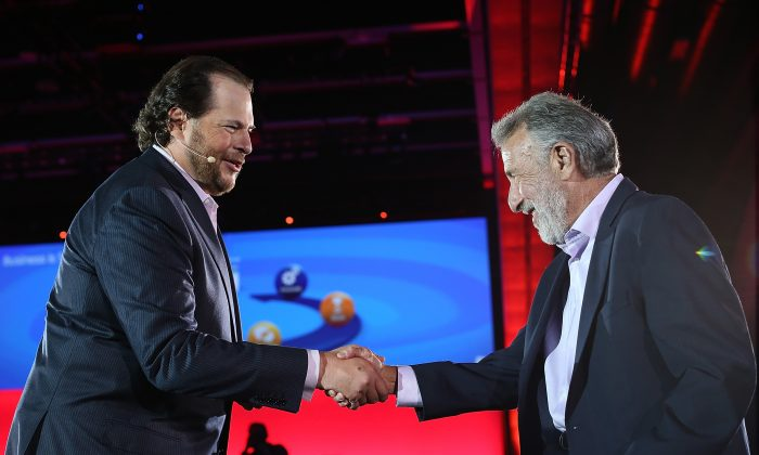 Mens' Wearhouse founder and CEO George Zimmer (R) shakes hands with Salesforce CEO Marc Benioff as he delivers the keynote address during the Dreamforce 2012 conference at the Moscone Center on September 19, 2012 in San Francisco, California. (Justin Sullivan/Getty Images)