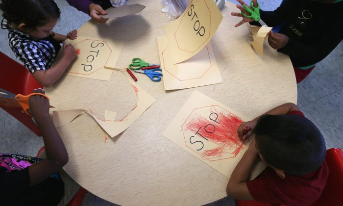 Children from low-income families draw at the federally funded Head Start school on Sept. 20, 2012, in Woodbourne, N.Y. Poor and low-income children are less safe than their affluent peers, according to a new report. (John Moore/Getty Images)