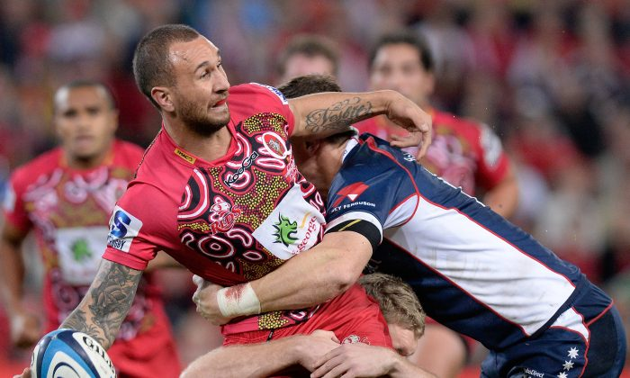 Under pressure, Quade Cooper passes, while playing for the Reds against the Rebels on Saturday June 1. (Bradley Kanaris/Getty Images)