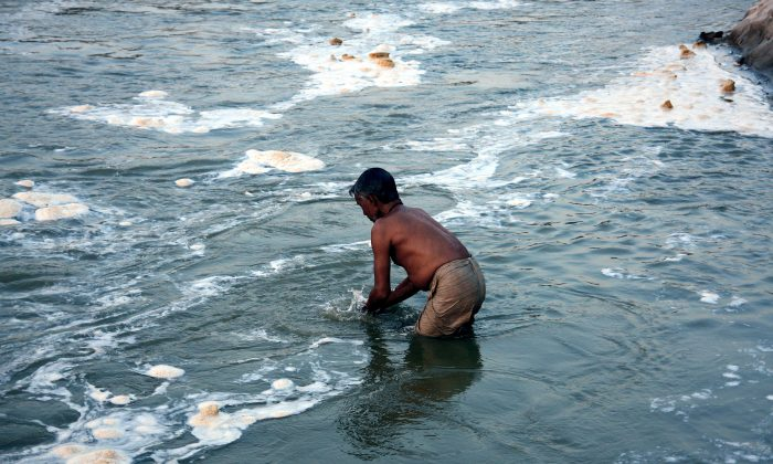 A man takes a holy dip in the polluted river Ganga (Ganges) in Allahabad on December 9, 2012. The Ganga is the largest river in India with an religious importance - flowing through 29 cities, a large proportion of the pollution of the river is from the population of these cities through domestic use. (Sanjay Kanojia/AFP/Getty Images)