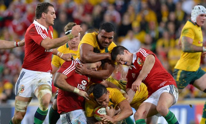The intensity of international rugby ... Wallabies wing Israel Folau is tackled during the First Test match between the Australian Wallabies and the British & Irish Lions at Suncorp Stadium on June 22, 2013 in Brisbane. (Bradley Kanaris/Getty Images)