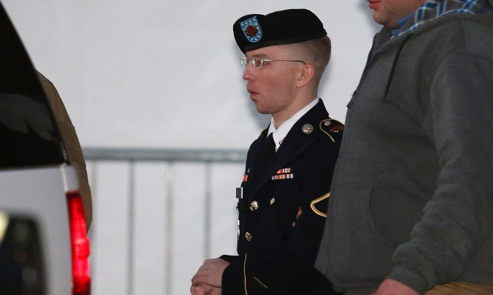 Pfc. Bradley E. Manning is escorted from an earlier portion of the trial, on January 8, 2013 in Fort Meade, Maryland. Manning pled guilty to leaking documents, and now military prosecutors are trying to prove that by doing so he was aiding the enemy, in the portion of the trial that started on June 3, 2013. (Mark Wilson/Getty Images)