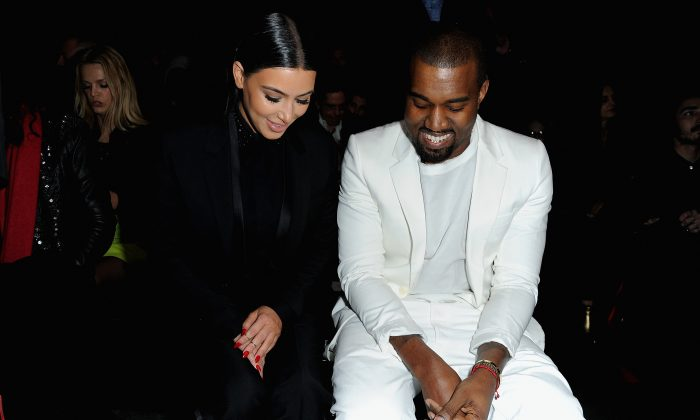 Kim Kardashian and Kanye West attend Givenchy Fall/Winter 2013 Ready-to-Wear show as part of Paris Fashion Week on March 3, 2013 in Paris, France. (Pascal Le Segretain/Getty Images)