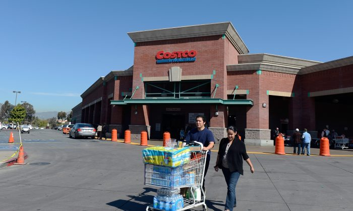 Customers push a loaded cart outside a Costco store in Los Angeles, March 12. Costco recently ranked No. 1 in a market survey due to its excellent customer experience and service. (Kevork Djansezian/Getty Images)