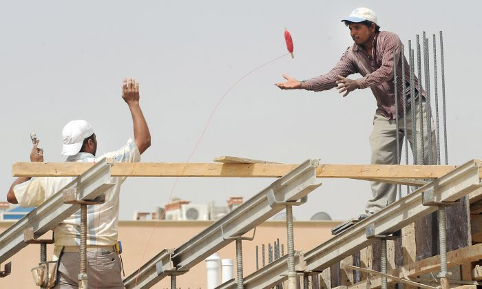 Foreign laborers work at a construction site in the Saudi capital Riyadh on April 10, 2013. (Fayez Nureldine/AFP/Getty Images)