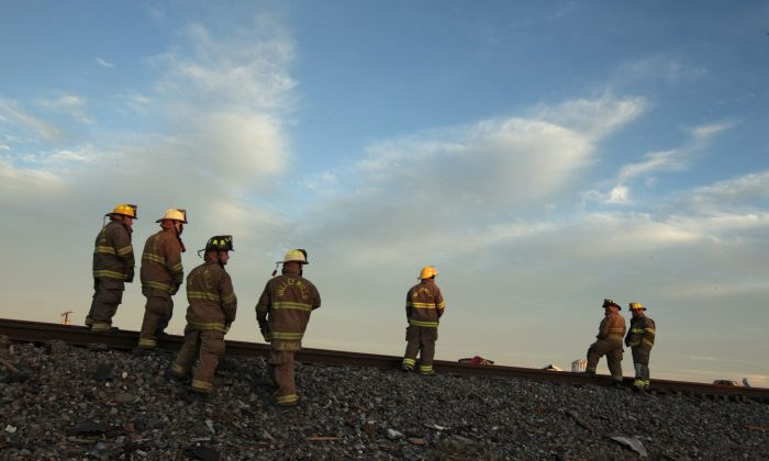 Valley Mills Fire Department personnel view the railroad tracks near to the fertilizer plant that exploded on April 18,  in West, Texas. According to West Mayor Tommy Muska, around 14 people were killed and more than 150 people were injured when the fertilizer company caught fire and exploded. Workplace safety varies across the United States and around the world. (Erich Schlegel/Getty Images)