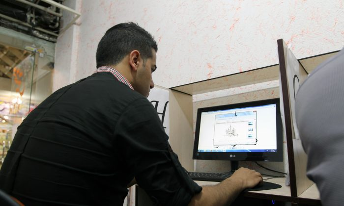 An Iranian uses a computer at a cybercafe in the center of the Iranian capital Tehran on May 14, 2013. Iran  tightened control of the Internet in the run up to the presidential election, mindful of violent street protests that social networkers inspired last time  (Atta Kenare/AFP/Getty Images)