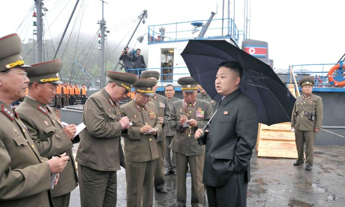 This undated picture released by North Korea's official Korean Central News Agency (KCNA) on May 28, 2013 shows North Korean leader Kim Jong-Un (R, front) inspecting the August 25 Fishery Station under the Korean People's Army. (KCNA/AFP/Getty Images)