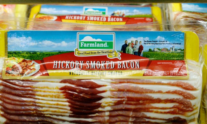 Farmland is one of several pork brands owned by Virginia-based Smithfield Foods Inc., the biggest pork producer in the world. A Chinese company based in Hong Kong, Shuanghui International Holdings Ltd. has agreed to buy Smithfield for approximately $4.72 billion. (Kevork Djansezian/Getty Images)
