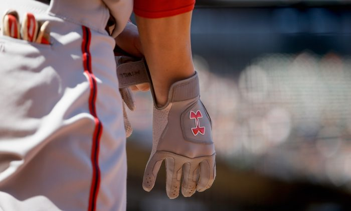 A detail shot of the Under Armour batting gloves worn by Bryce Harper #34 of the Washington Nationals during a May 22 game. Under Armour announced on May 5 an aggressive international growth plan, including an expectation of more than doubling revenue by 2016. (Ezra Shaw/Getty Images)