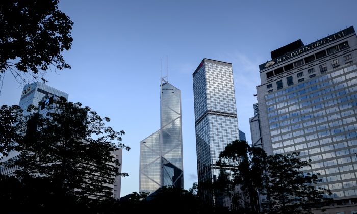 The Bank of China (C) is seen among other high rise buildings in Hong Kong's financial district on May 30, 2013. Chinese interbank lending rates have spiked recently, suggesting a full blown banking crisis is in the making. (Philippe Lopez/AFP/Getty Images)