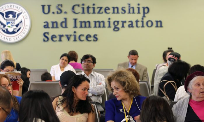 Immigrants await their turn for green card and citizenship interviews at the U.S. Citizenship and Immigration Services Queens office in the Long Island City neighborhood of New York City, on May 30, 2013. (John Moore/Getty Images)