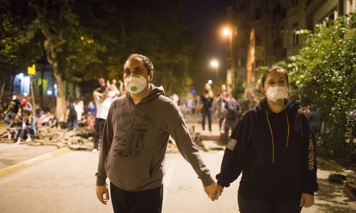 Protestors hold hands during clashes with police in Istanbul on Tuesday night (Uriel Sinai/Getty Images)