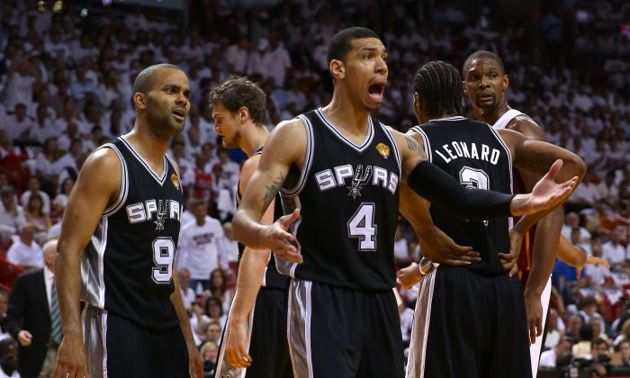 (L-R) Tony Parker #9 and Danny Green #4 of the San Antonio Spurs react in the first quarter while taking on the Miami Heat during Game One of the 2013 NBA Finals at AmericanAirlines Arena on June 6, 2013 in Miami, Florida. (Mike Ehrmann/Getty Images)