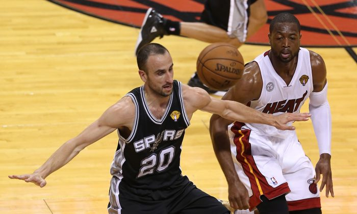 Manu Ginobili #20 of the San Antonio Spurs and Dwyane Wade #3 of the Miami Heat go after a loose ball in the second quarter during Game One of the 2013 NBA Finals at AmericanAirlines Arena on June 6, 2013 in Miami, Florida. (Christian Petersen/Getty Images)