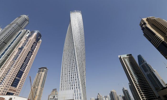 The Cayan tower (C), the world's tallest twisted tower stands at Dubai's Marina in the United Arab Emirates, UAE, June 11, 2013. (KARIM SAHIB/AFP/Getty Images)