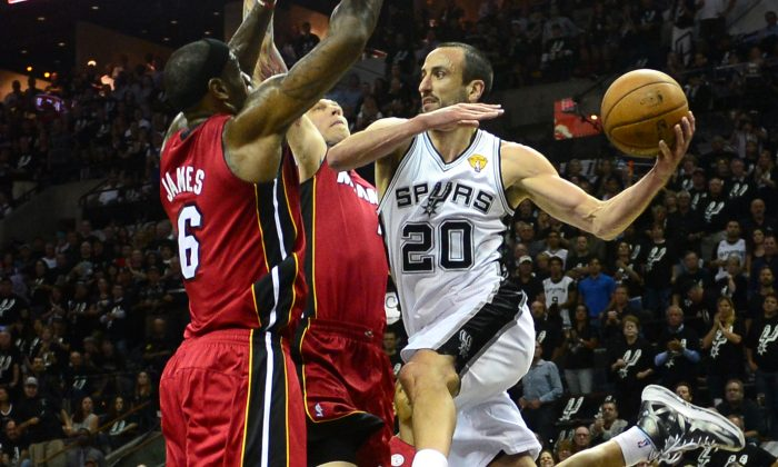 Manu Ginobili (R) of the San Antonio Spurs looks to pass under pressure from LeBron James (L) and Chris Andersen of the Miami Heat during game three of the NBA Finals on June 11, 2013 in San Antonio, Texas. (Frederic J. Brown/AFP/Getty Images)
