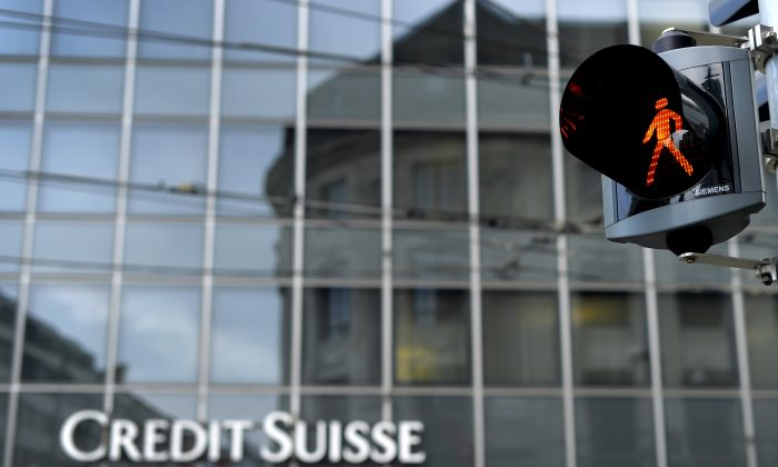 A traffic light is seen in front of a Credit Suisse branch on June 11, 2013 in Basel. The Swiss bank was the latest company to decide to cease publishing the volumes of its dark pool stock exchange. (Fabrice Coffrini/AFP/Getty Images)