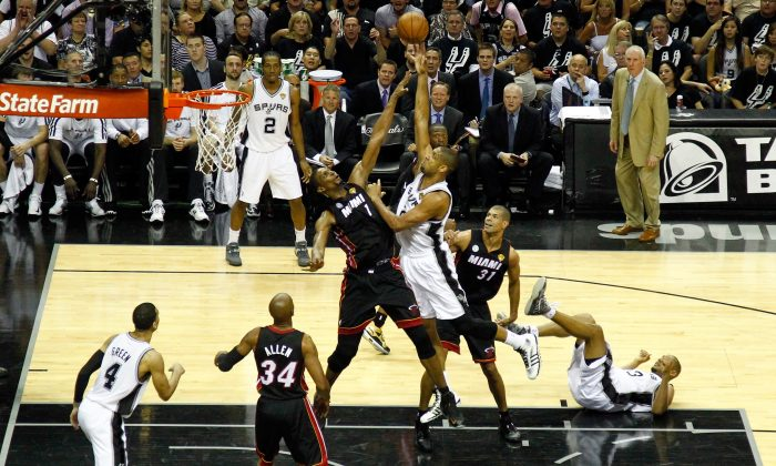 Tim Duncan #21 of the San Antonio Spurs goes up for a shot over Chris Bosh #1 of the Miami Heat in the first half during Game 5 of the 2013 NBA Finals at the AT&T Center on June 16, 2013 in San Antonio, Texas. The Spurs won 114-104.  (Mike Ehrmann/Getty Images)