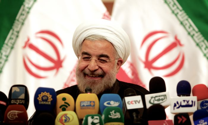 Iranian President-elect Hassan Rowhani smiles during a press conference in Tehran on June 17, 2013. (Behrouz Mehri/AFP/Getty Images)