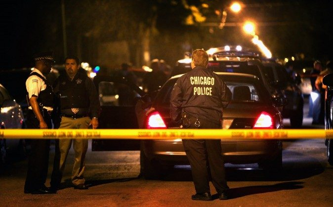 Local media reports say that at least 41 people were shot in Chicago in a 24-hour-period from 11 a.m. Saturday to Sunday morning, leaving at least three dead. (Scott Olson/Getty Images)
