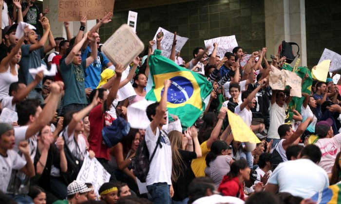 Protesters shout during a demonstration in Belo Horizonte, Brazil, June 19, 2013. Protests initially sparked by a hike in bus fares in São Paulo quickly spiraled into nationwide marches against corruption. (Bernardo Salce/AFP/Getty Images)