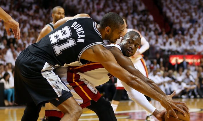 Dwyane Wade #3 of the Miami Heat looks to pass the ball against Tim Duncan #21 of the San Antonio Spurs in the first quarter during Game Seven of the 2013 NBA Finals at AmericanAirlines Arena on June 20, 2013 in Miami, Florida. (Mike Ehrmann/Getty Images)