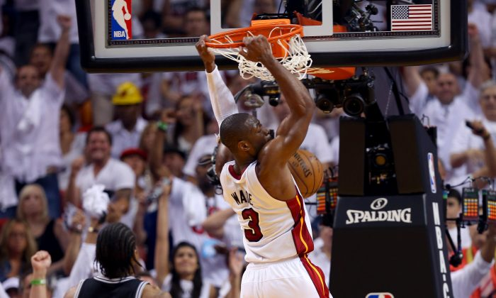 Dwyane Wade #3 of the Miami Heat dunks the ball in front of Kawhi Leonard #2 of the San Antonio Spurs in the third quarter during Game Seven of the 2013 NBA Finals at AmericanAirlines Arena on June 20, 2013 in Miami, Florida. (Mike Ehrmann/Getty Images)