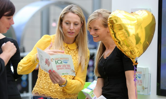Presenter Sam Mann (L) is talking to a customer, inviting shoppers to take part in the Nestle Cereals Breakfast IQ Challenge at the Westfield mall in London, England. When building a business, it pays to go back to basics and focus on the customer. (Tim P. Whitby/Getty Images for Nestle)