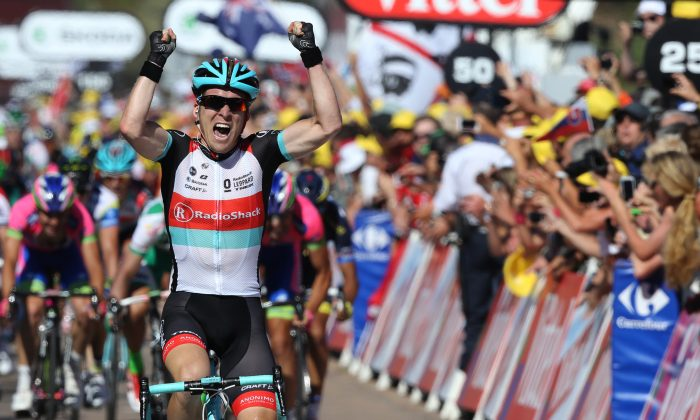 Jan Bakelants celebrates as he crosses the finish line at the end of the 156 km Stage Two of the 100th edition of the Tour de France cycling race on June 30, 2013 between Bastia and Ajaccio, on the French Mediterranean Island of Corsica. (Pascal Guyot/AFP/Getty Images)