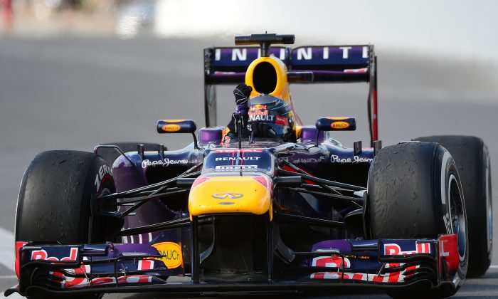 Sebastian Vettel of Red Bull pumps his fist in triumph after winning the Formula One Canadian Grand Prix at the Circuit Gilles Villeneuve in Montreal on June 9, 2013. (Emmanuel Dunand/AFP/Getty Images)