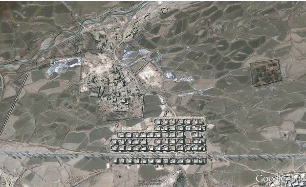 A screengrab of a Google Earth aerial view of Tibet in 2012. Most houses were demolished and rebuilt into a neat grid. (Google Earth via Human Rights Watch)