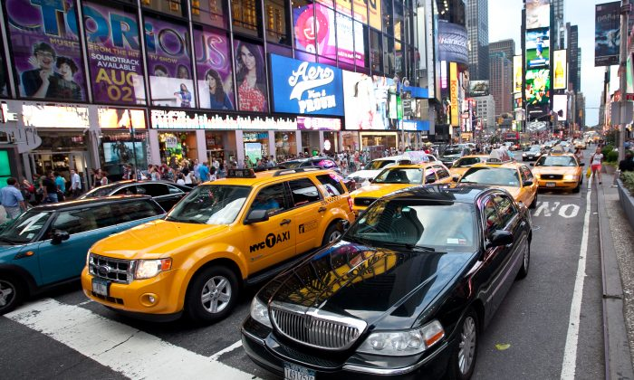 A file photo of a livery cab next to a taxi cab on 6th Ave in Manhattan. (The Epoch Times)