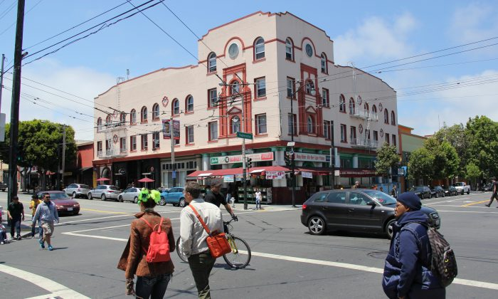 Pedestrians on Valencia Street in the Mission District in San Francisco, Calif., June 5. Merchants reported that more residents shop locally after Valencia Street received safety improvements, like sidewalk widening and traffic-lane slimming. (Christian Watjen/The Epoch Times)