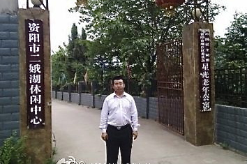 Jiang Tianyong, a human rights lawyer in China, stands outside the Erehu Legal Education Center, also known as a brainwashing center, on May 13. He was part of a group that visited the facility. (Courtesy of Jiang Tianyong)