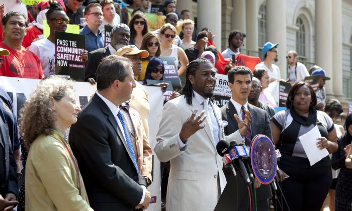 Council Member Jumaane D. Williams speaks on the City Hall steps, June 24, 2013, in support of bills seeking to reduce racial profiling and establish inspector general oversight of the NYPD. (Samira Bouaou/Epoch Times)