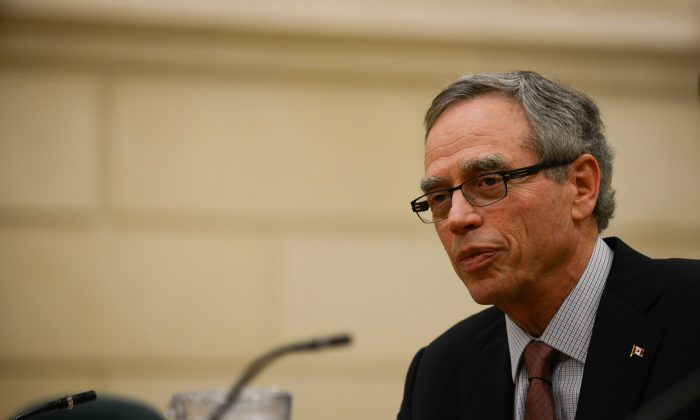 Minister of Natural Resources Joe Oliver waits to testify at the Standing Committee on Natural Resources on Parliament Hill on April 16. Oliver announced increased requirements on pipeline operators Wednesday. (Matthew Little/The Epoch Times)