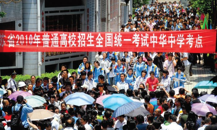 """Having just taken the """"gaokao,"""" or college entrance exam, students walk out of the test site at the China Middle School in Nanjing City. The exam, which was given throughout China during the period June 6-9, has traditionally been seen as the gateway to higher education and a good job. (The Epoch Times Photo Archive)"""