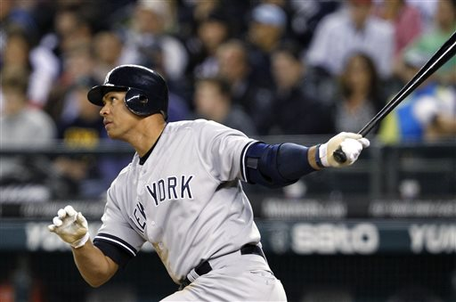 In this July 23, 2012, file photo, New York Yankees' Alex Rodriguez watches a home run against the Seattle Mariners in a baseball game in Seattle.  (AP Photo/Elaine Thompson, File)