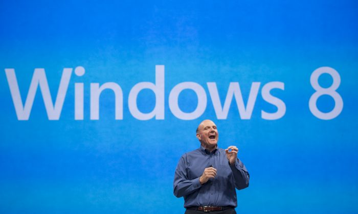 In this 2012 file photo, Microsoft CEO Steve Ballmer comments on the Windows 8 operating system. Ballmer announced that he would retiring from Microsoft within a year. (AP Photo/Damian Dovarganes)