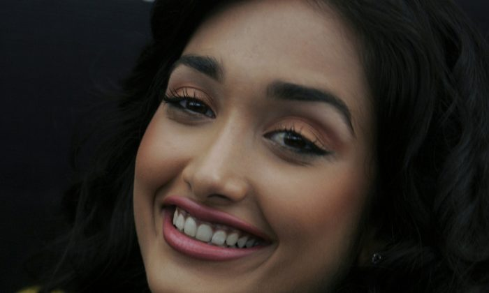"FILE- In this Dec. 19, 2008 file photo, Bollywood actress Jia Khan smiles during a promotional event of her forthcoming Hindi movie 'Ghajini' in Bangalore, India. Police said that Khan was found dead at her home in Mumbai late Monday, June 3, 2013. Khan began her career in Mumbai's film industry in the 2007 Hindi film ""Nishabd"" in which she portrayed a teenager in love with her best friend's father, played by Bollywood superstar Amitabh Bachchan. (AP Photo/Aijaz Rahi, file)"