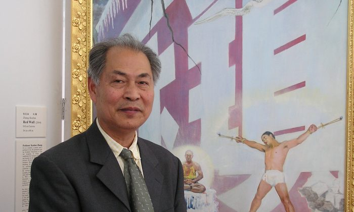 """Former Art Professor Zhang Kunlun is pictured standing in front of his Painting """"Red Wall."""" Zhang said this painting is a realistic portrait of some of the torture methods used on Falun Gong practitioners incarcerated in China's forced labor camps, but in general it also represents the torture and terror that 1.3 billion Chinese people have been subjected to since the Chinese Communist Party seized power. (Epoch Times)"""